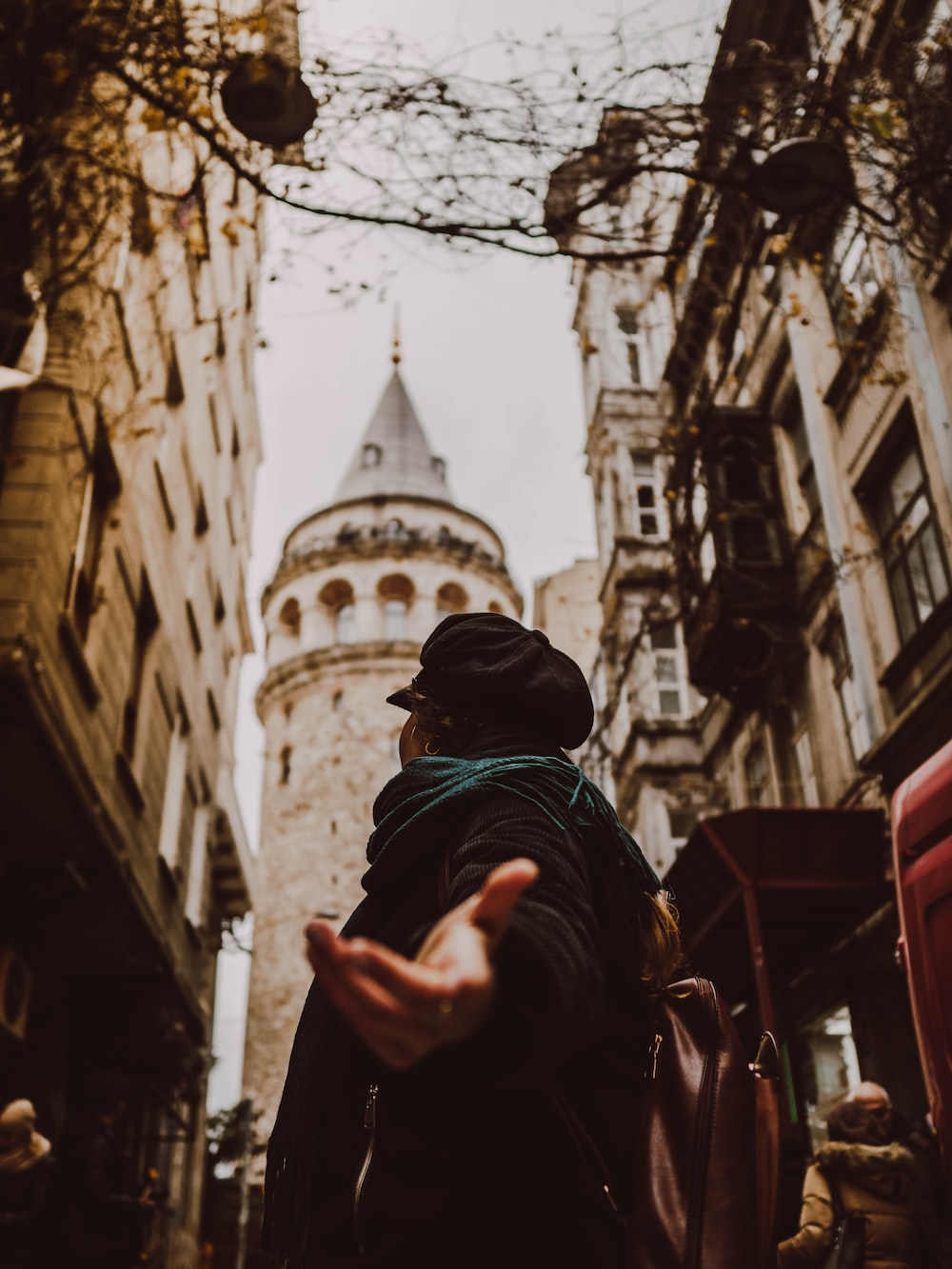 man standing in front of galata tower