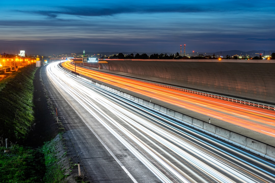 Time Lapse Photo of Cars Passing By During Nighttime - unsplash