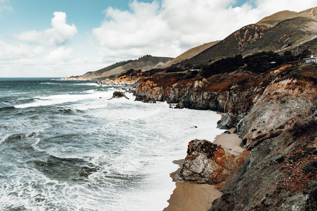 Cough Cliffs and Waves Beside the Highway 1. - unsplash