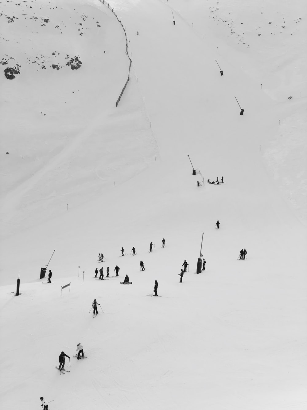 snowboarders on snow hill