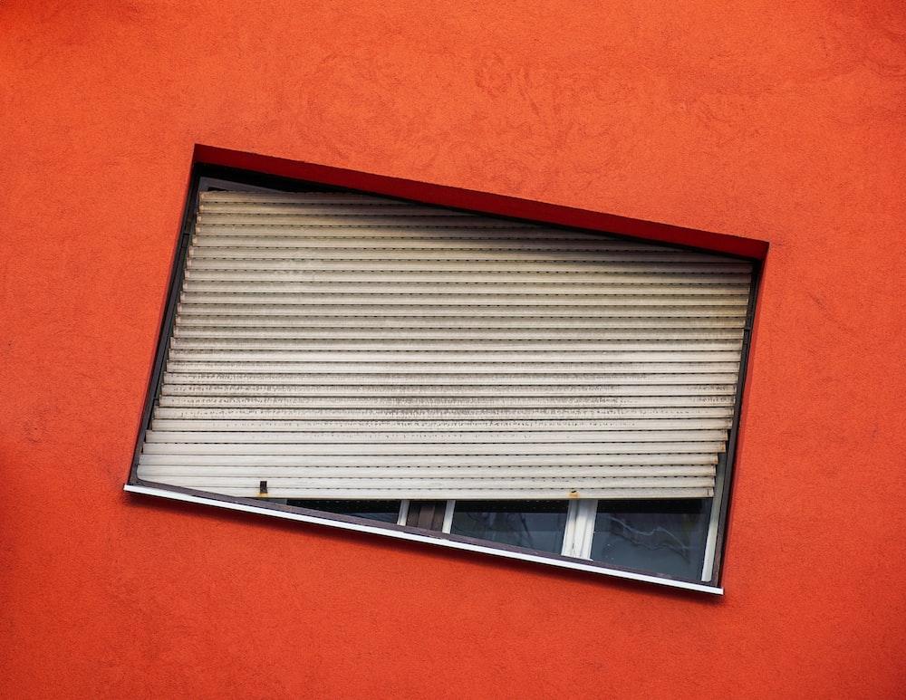 gray Venetian blind hanging on a window