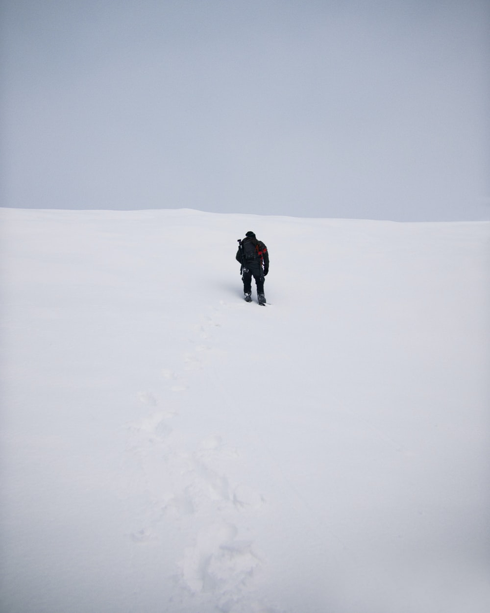 person in snowfield during daytime