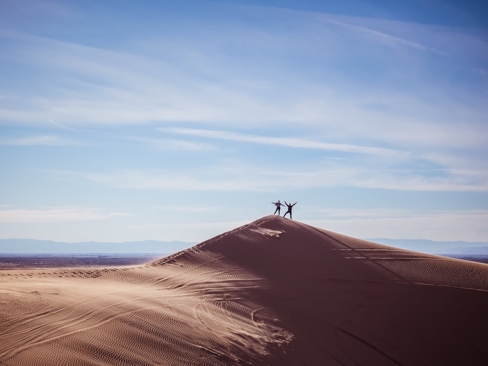 two persons on top of hill