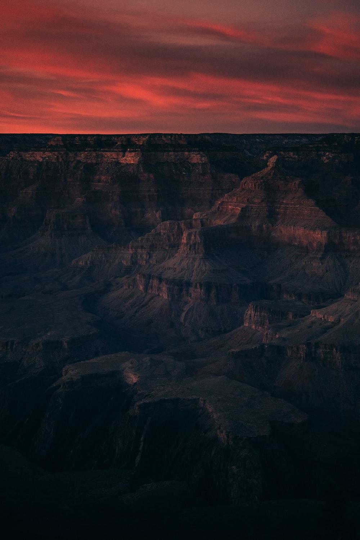 badlands under reddish sky