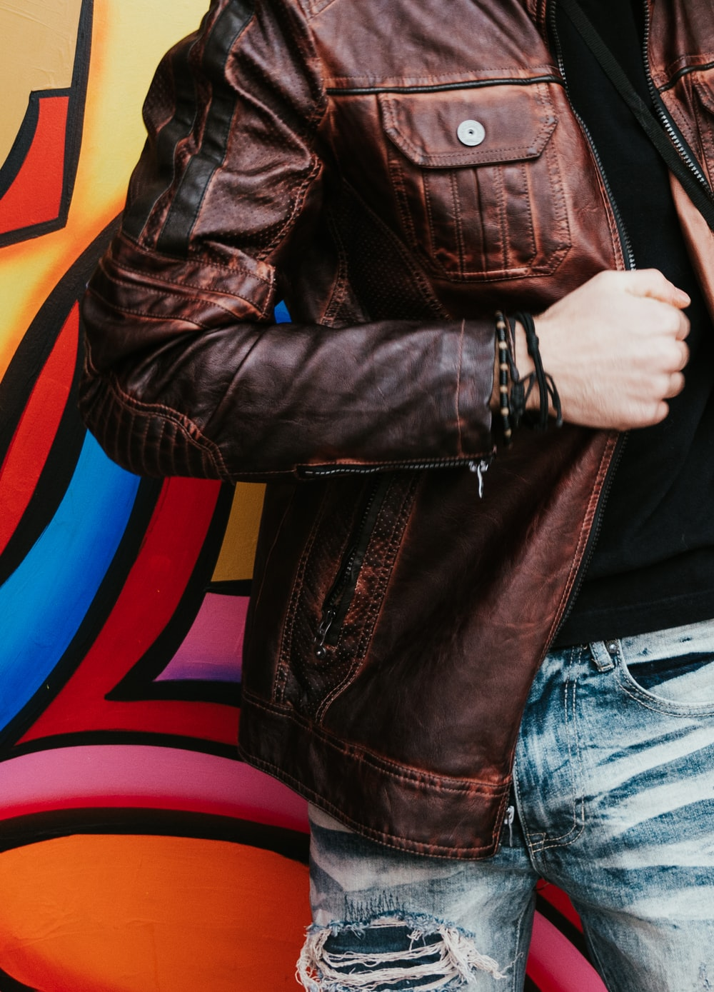 person in brown leather zip-up jacket