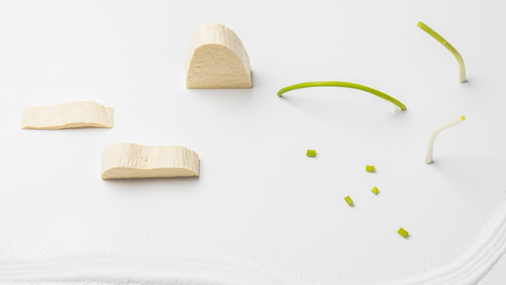 sliced white cheese and green spring onions