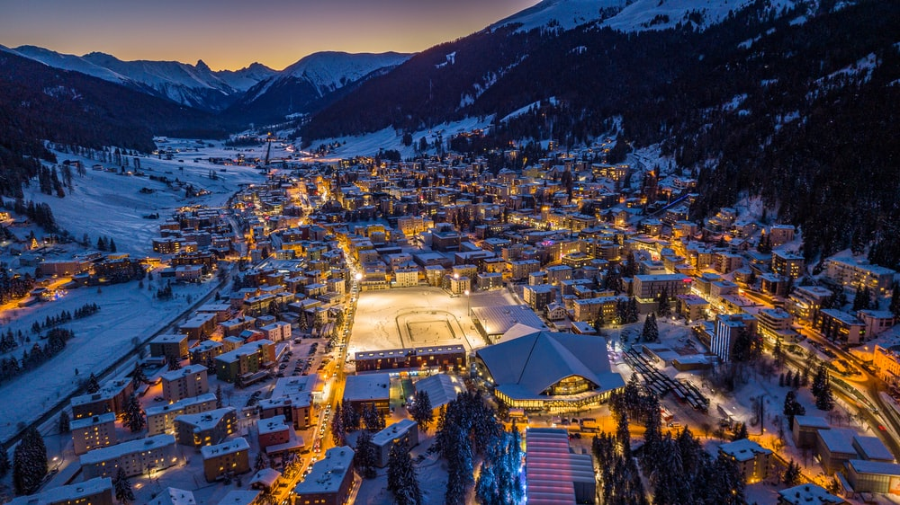 aerial photography of a snowy village during nighttime