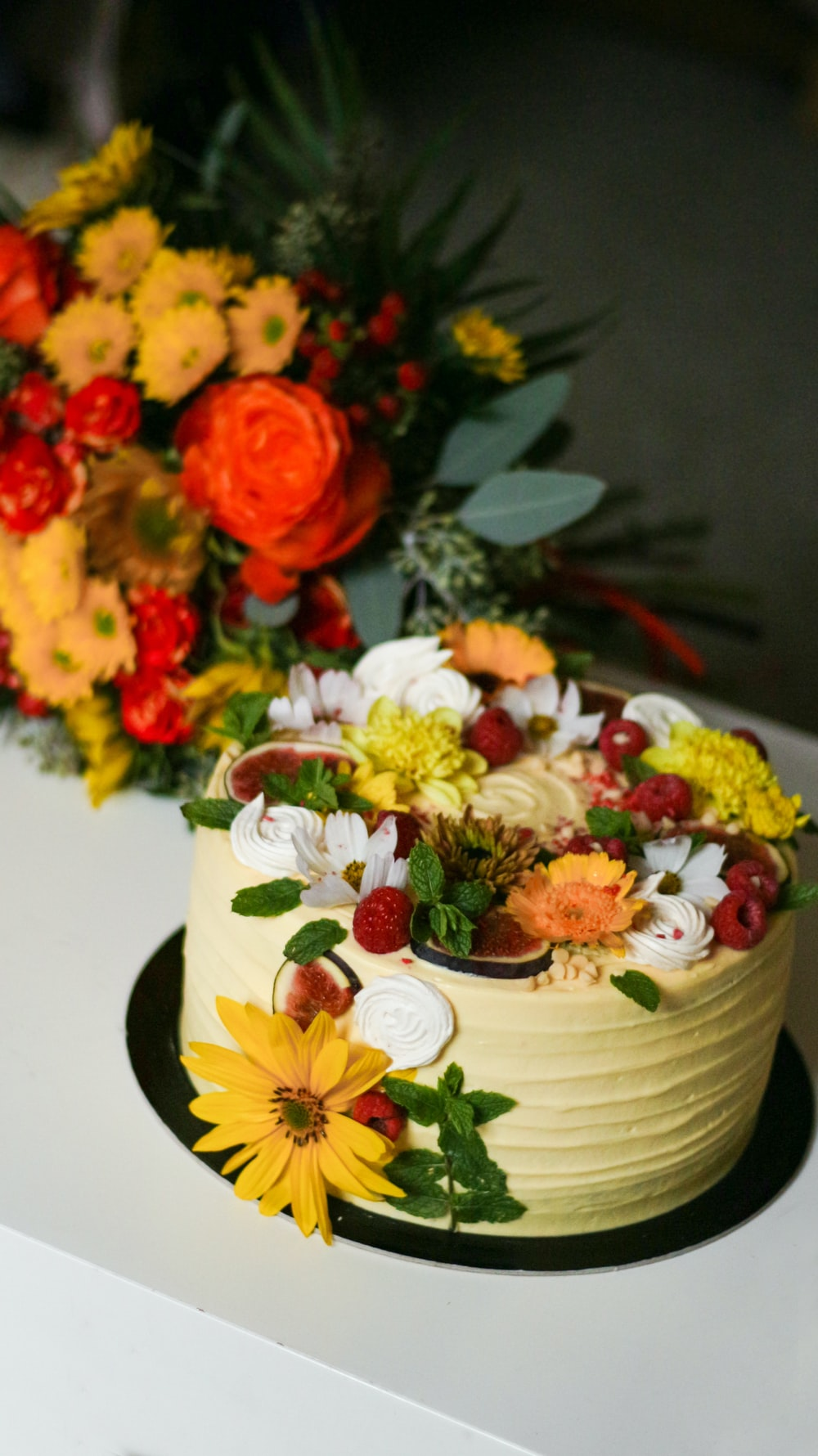 cake with flowers toppings on black base