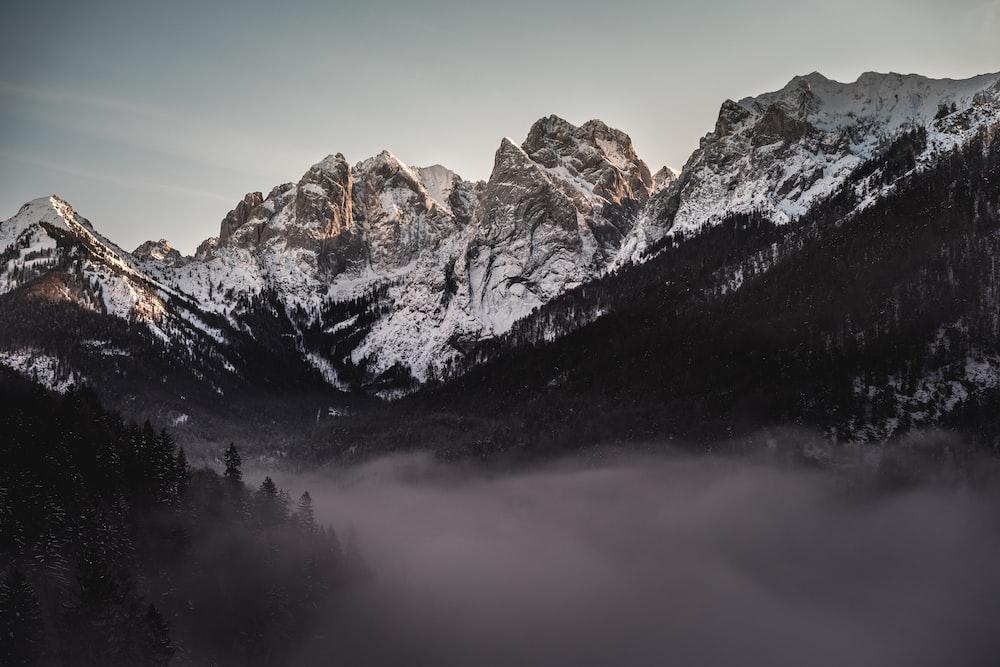 rocky mountain under gray ky