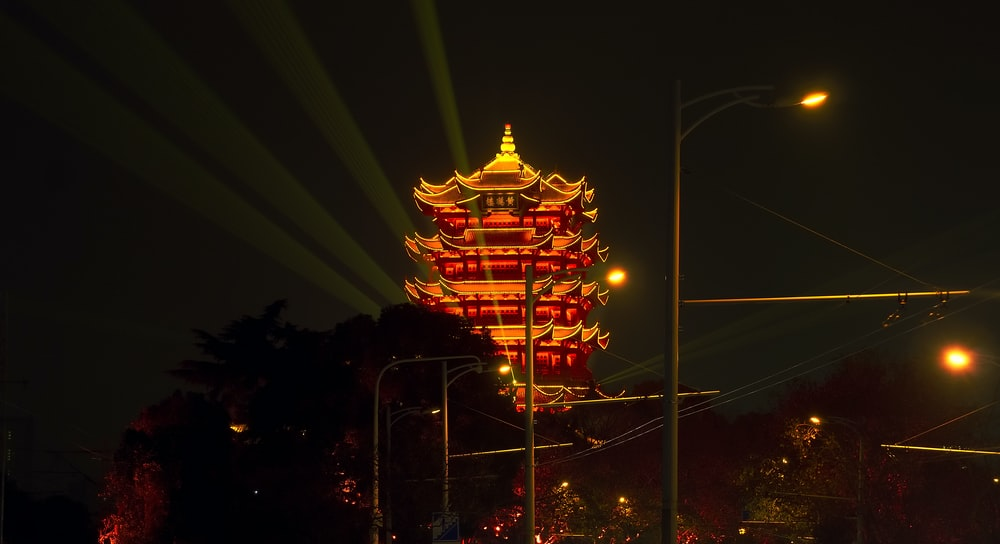red and yellow concrete temple during nighttime