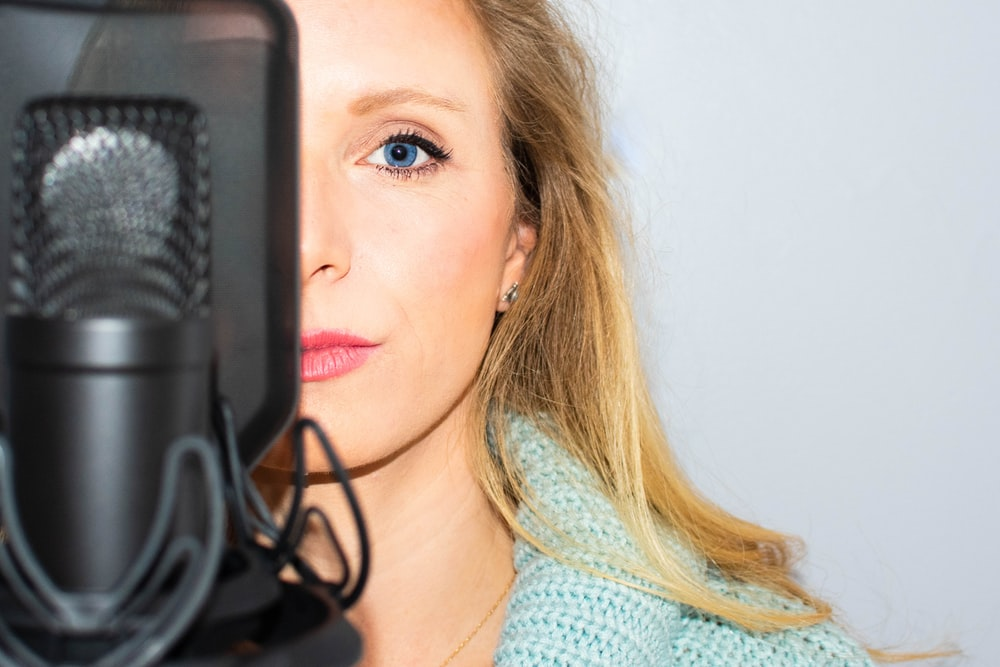 woman standing in front of the microphone