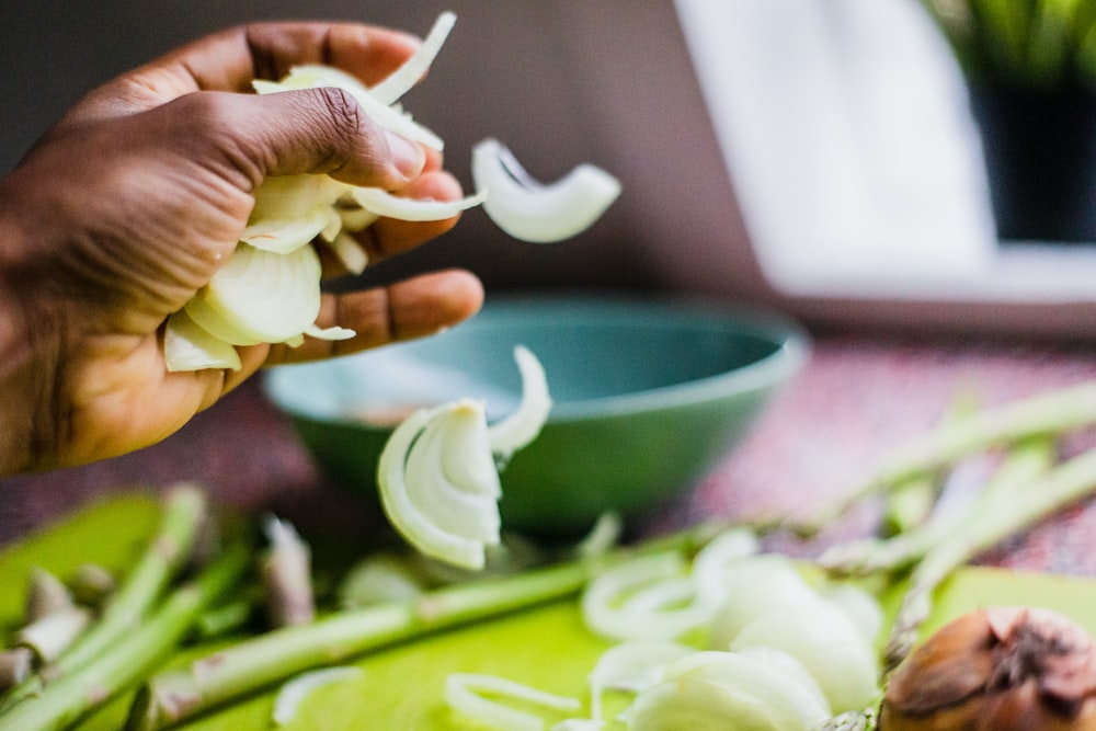 time-lapse photography of person pouring slices of onions