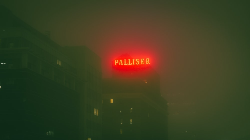 Palliser neon signage during nighttime