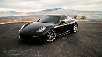 black coupe on road during daytime porsche teams background