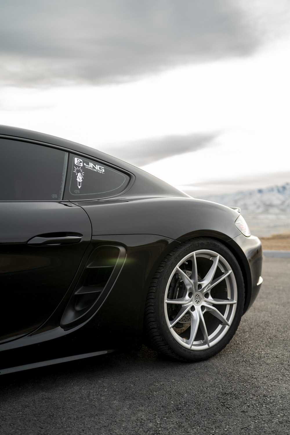 black coupe on road during daytime