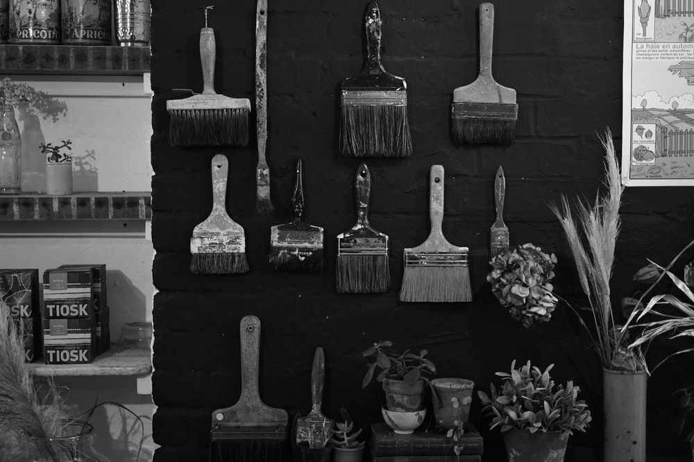grayscale photography of different paint brushes