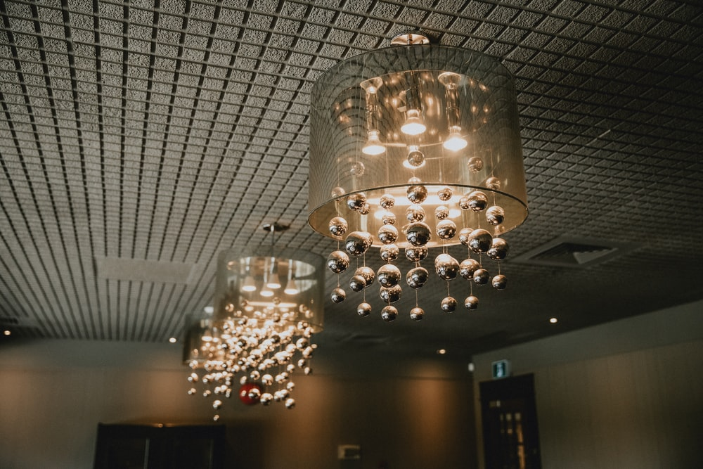 turned-on chandeliers