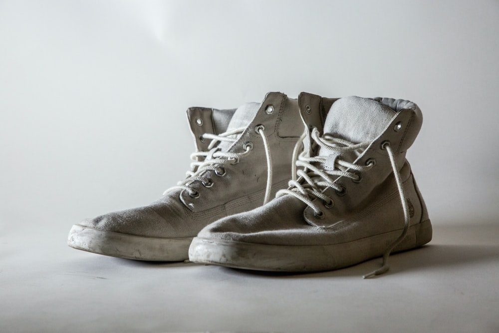 white lace-up high-top shoes