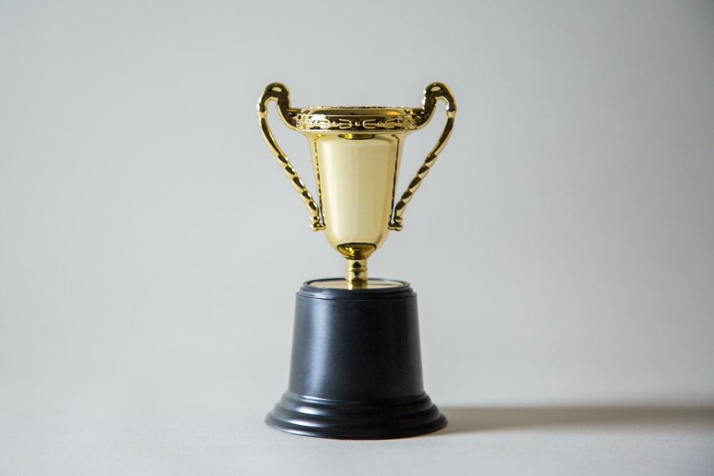 yellow and white trophy