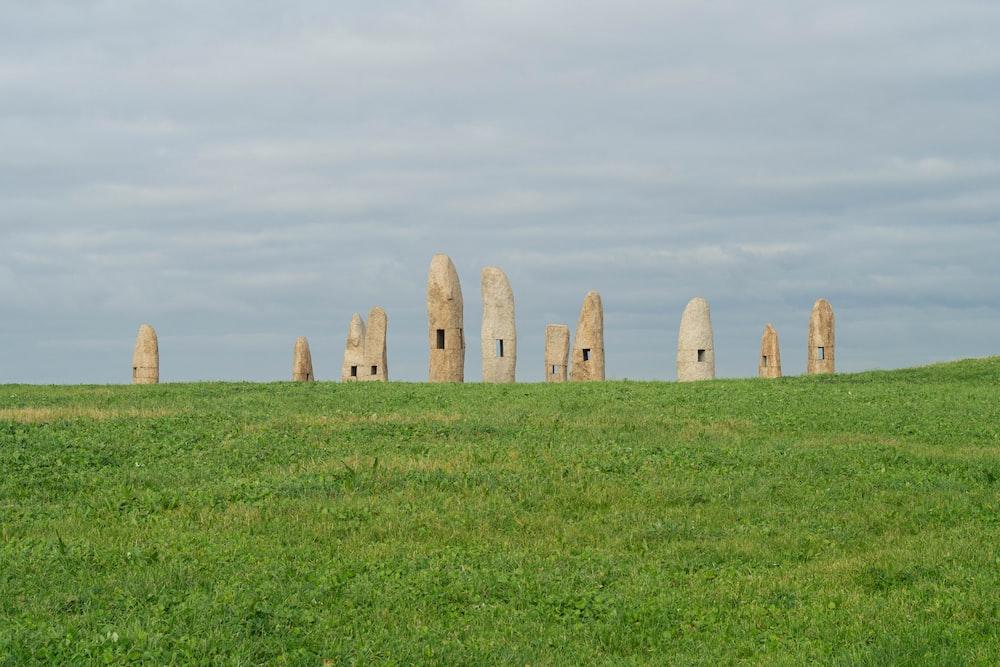monolith on green grass field