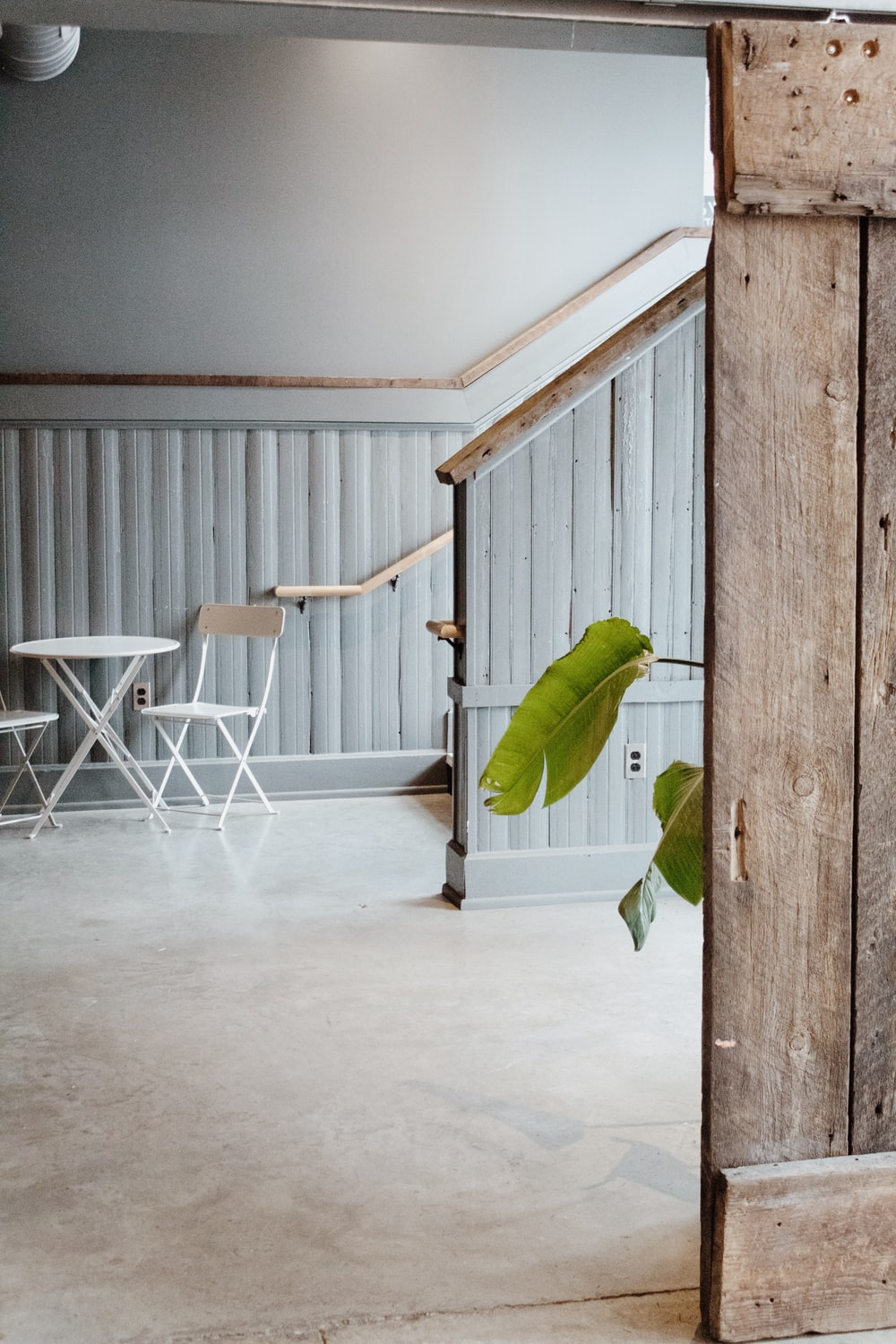 white steel chair and table near staircase