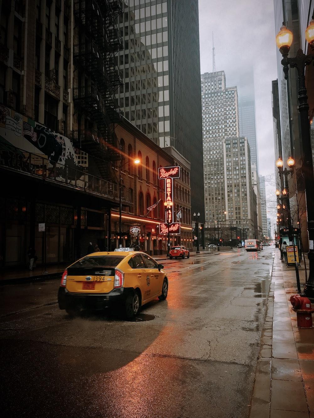yellow sedan on road