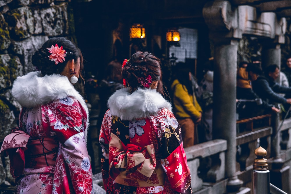 two women in red and white floral kimono dresses