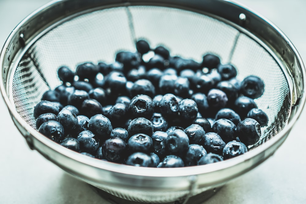 clear glass bowl of blueberries