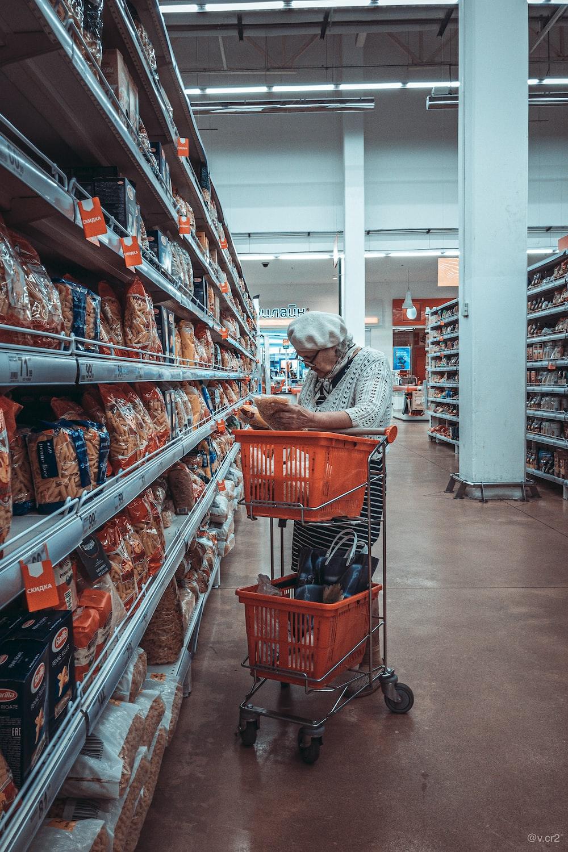 woman standing near shopping cart
