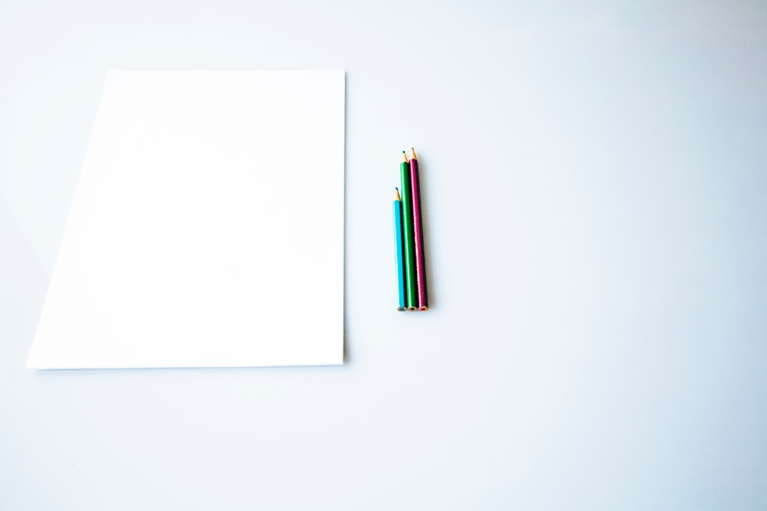 White Blank Paper Notepad With Colored Pencil - unsplash