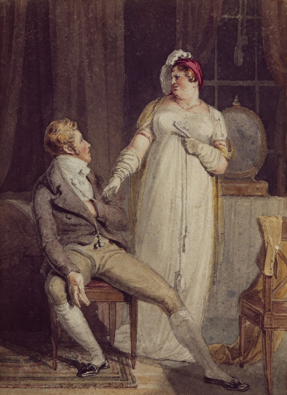 man sitting beside woman painting