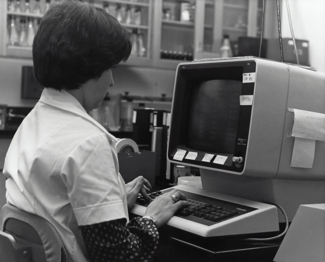 This Historic 1980's Photograph, Taken Within What Was A National Communicable Disease Center (ncdc), Influenza Testing Laboratory, Depicted Penny Gentry, A Laboratorian, Entering Data Into An Influenza-Specific Database, While Seated At A Computer Work - unsplash