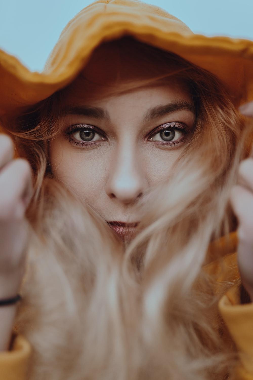 woman wearing brown hat taking selfie