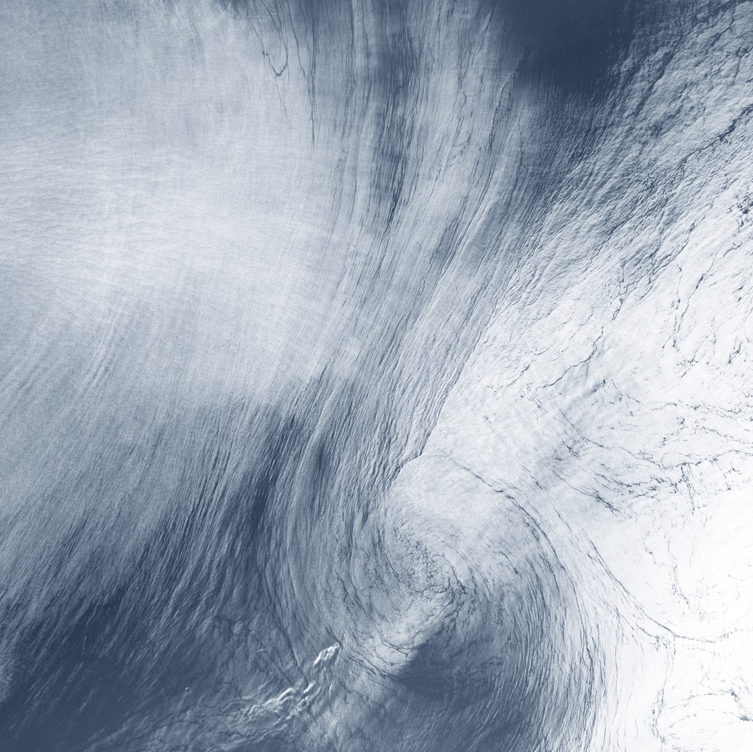 a Giant Whirlpool Cloud, Coaxed Into Shape By High-Altitude Winds, Swirls Above the Sea Between Spain and Morocco. - unsplash