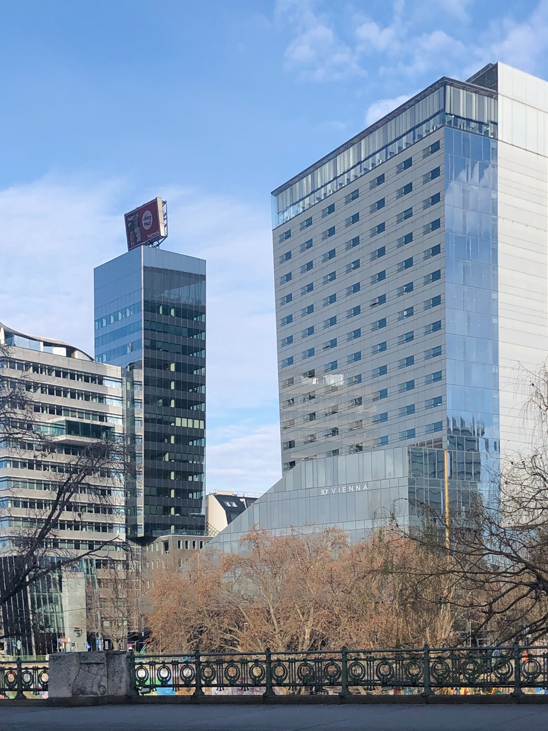 The Vienna Sofitel (SO Vienna) by Jean Nouvel and the Generali Media Tower by Hans Hollein  in the background. Both towers are not  perpendicular, hence the seeming distortion.