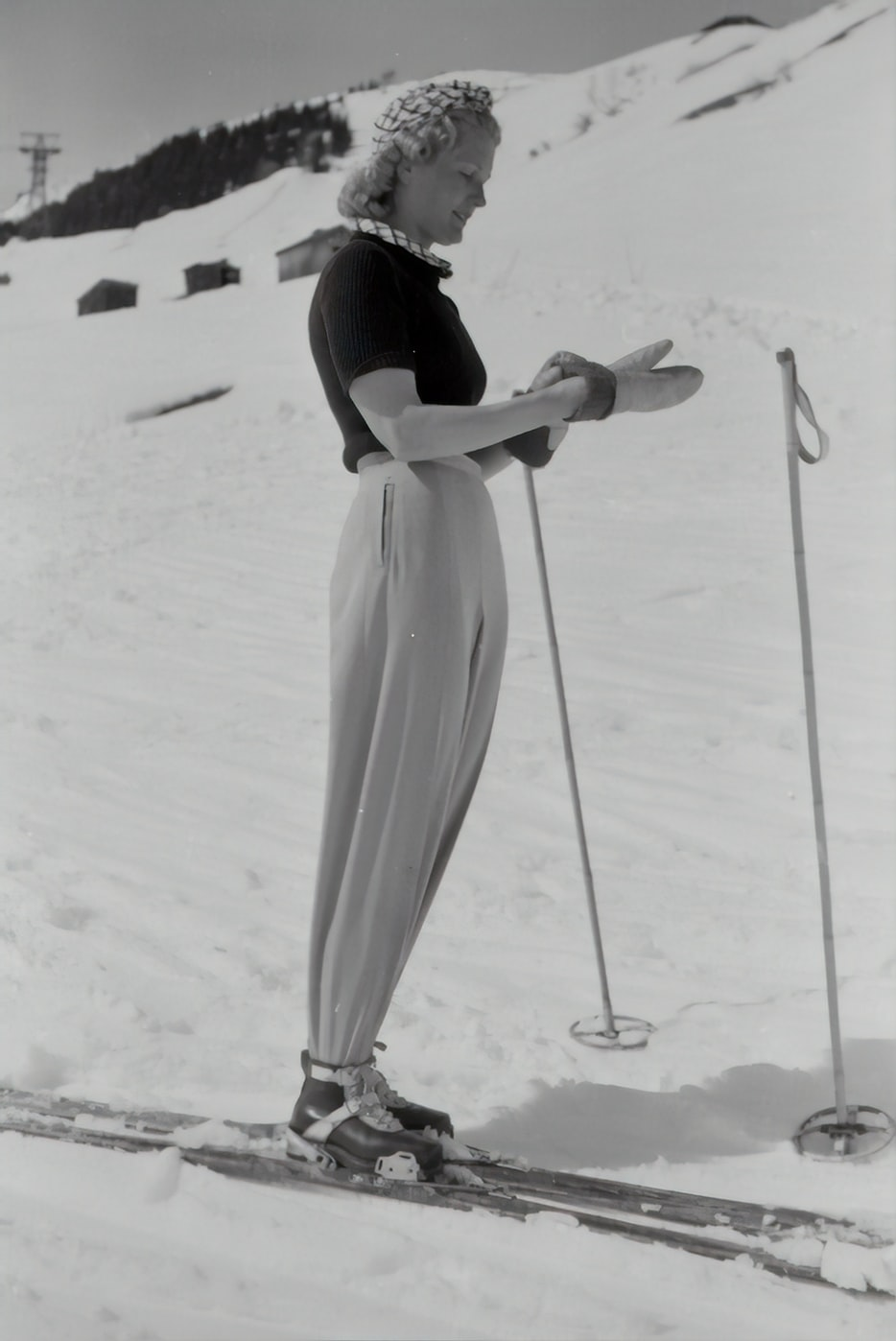 greyscale photography of woman using snowboard skis 1940