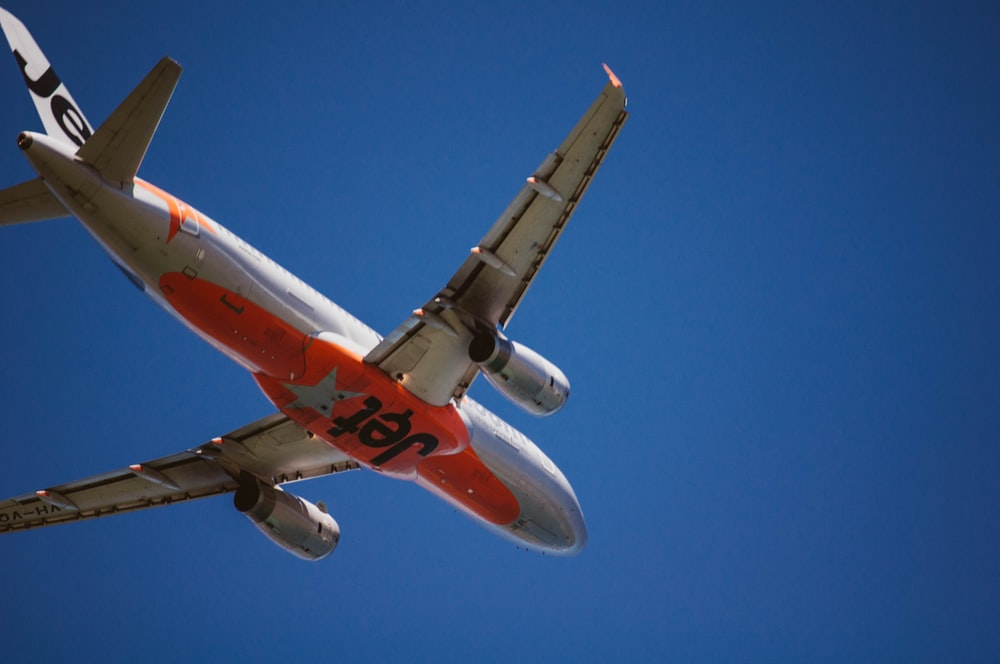 gray and orange Jet airplane