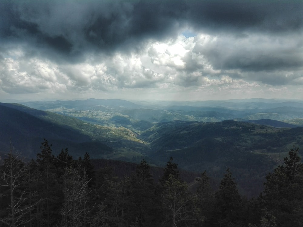 green mountain under cloudy sky during daytime