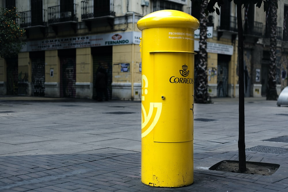 cylindrical yellow steel mail box