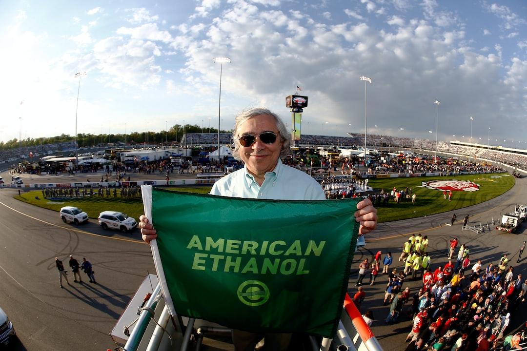 Secretary Ernest Moniz displays the green flag prior to the NASCAR race at the Richmond International Raceway. Photographer Jeff Zelevansky