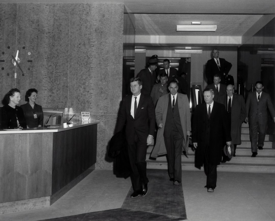 President Kennedy Walks Through the North Lobby As He Exits the Atomic Energy Commission Headquarters In Germantown. Behind the President Are Chairman Glenn T. Seaborg (center), Commissioner Loren K. Olsen, Commissioner Robert E. Wilson (extreme Right), a - unsplash