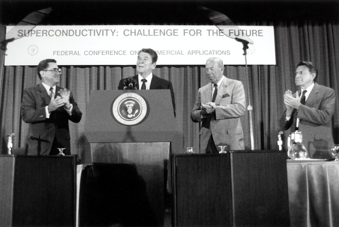 President Ronald Reagan speaks at Superconductivity Conference July 1987 with Secretary of Energy Herrington, Secretary of State Schultz and Secretary of Defense Weinberger .