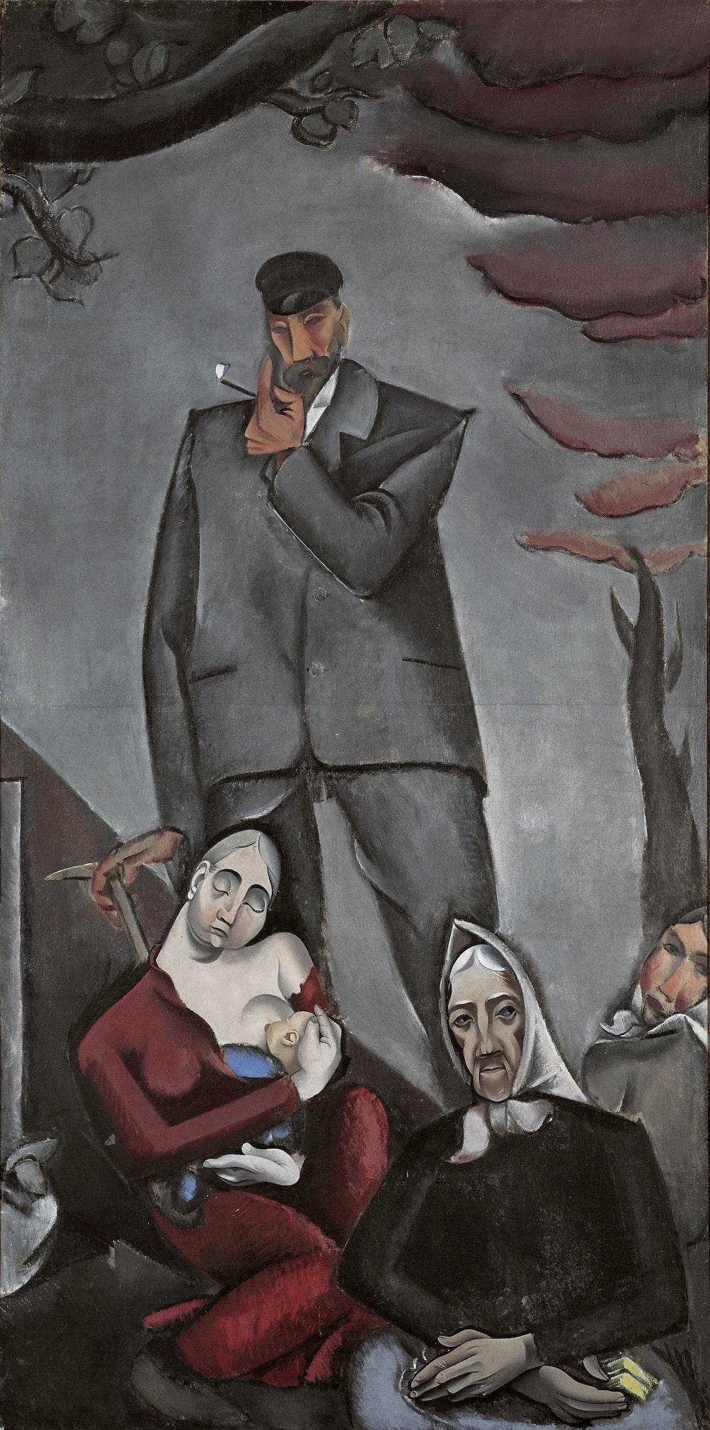 man in black suit jacket beside woman in red dress painting