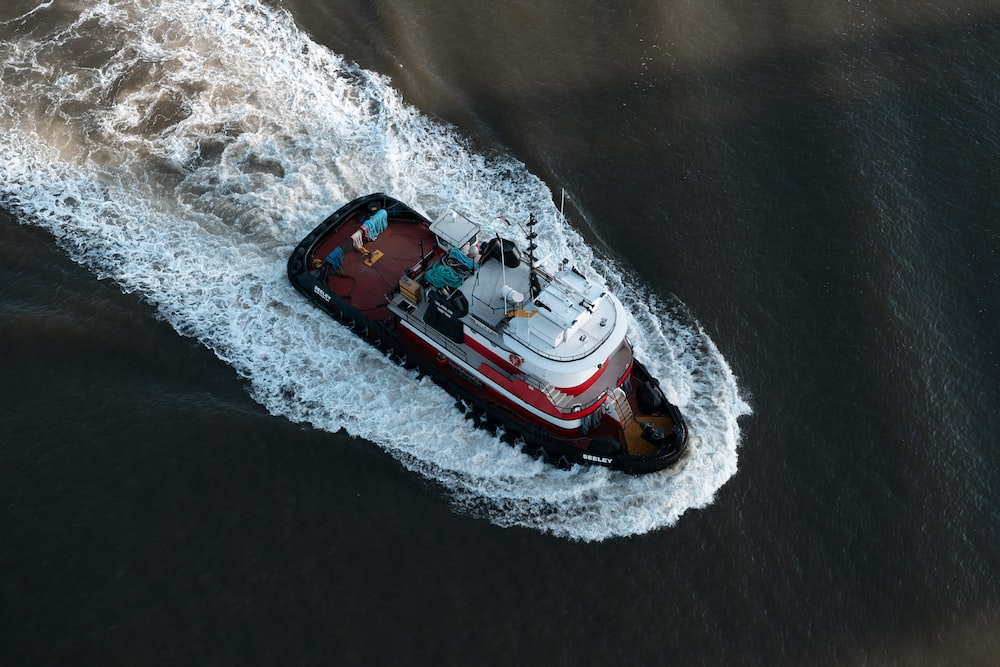red and white ship photograph