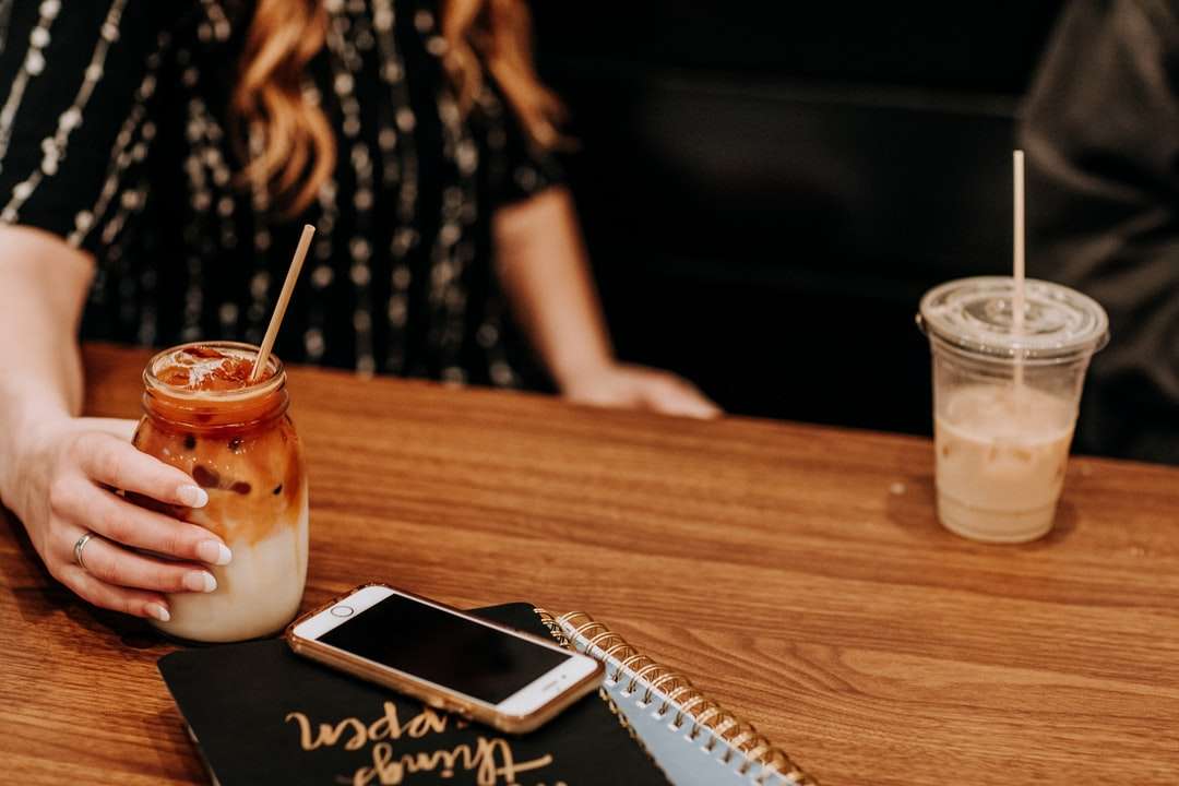 Yes Coffee Co.  Flagler Beach Fl. Mason Jar, Red Ream, Iced Latte, Flat Lay, Iced Drink, Hands, Coffee Date - unsplash