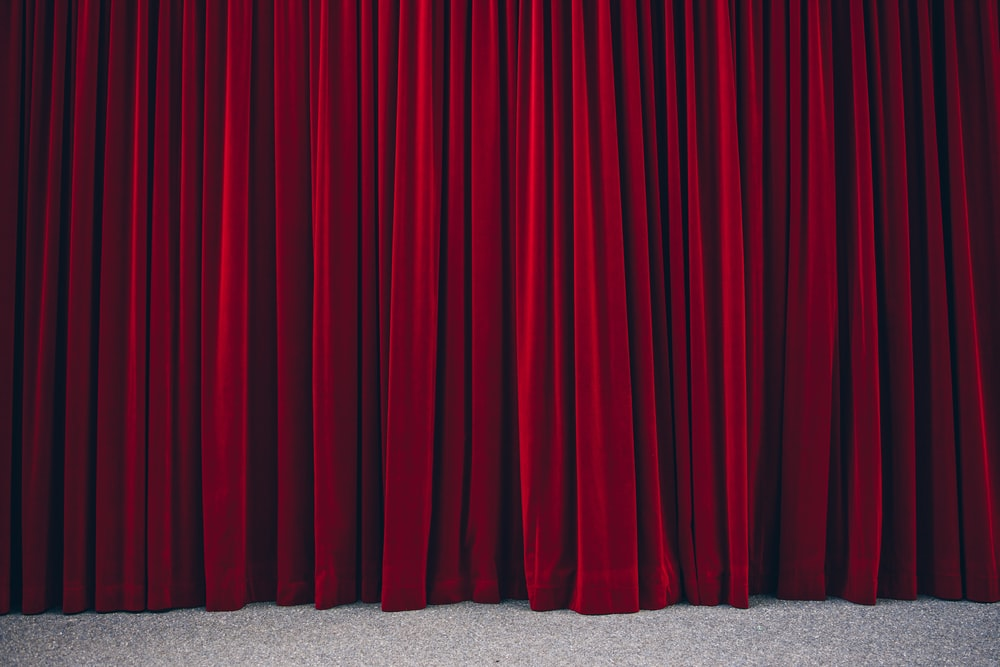 red pleated stage curtain