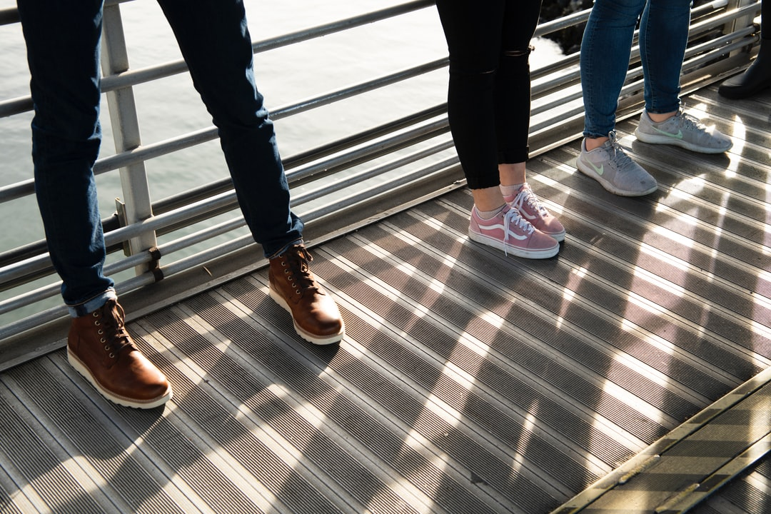 Legs and Shoes On A Pier - unsplash