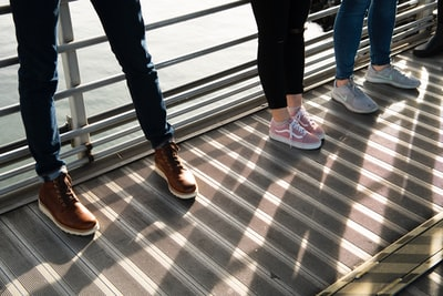 Legs and Shoes on a Pier