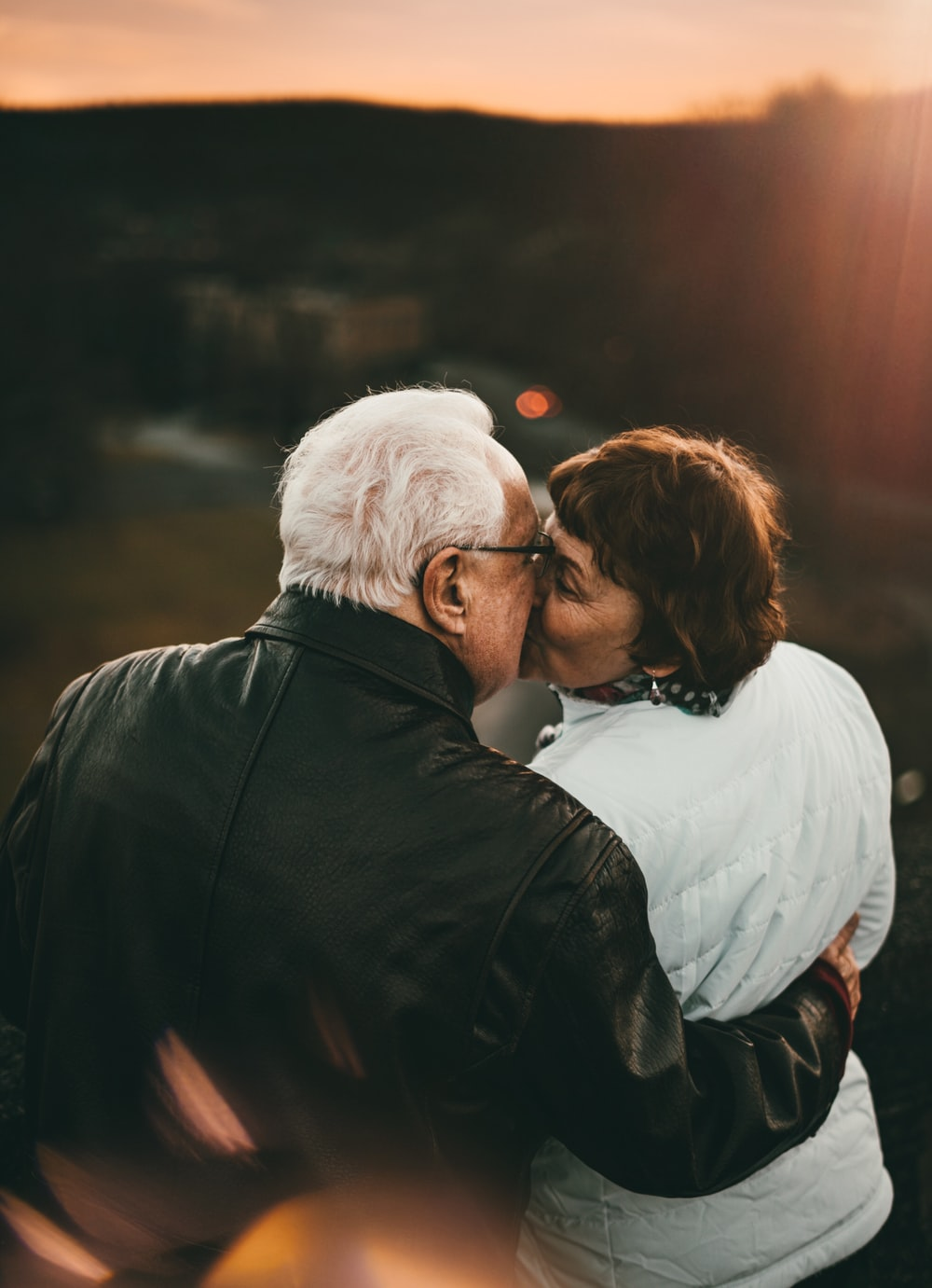 selective focus photography of kissing man and woman