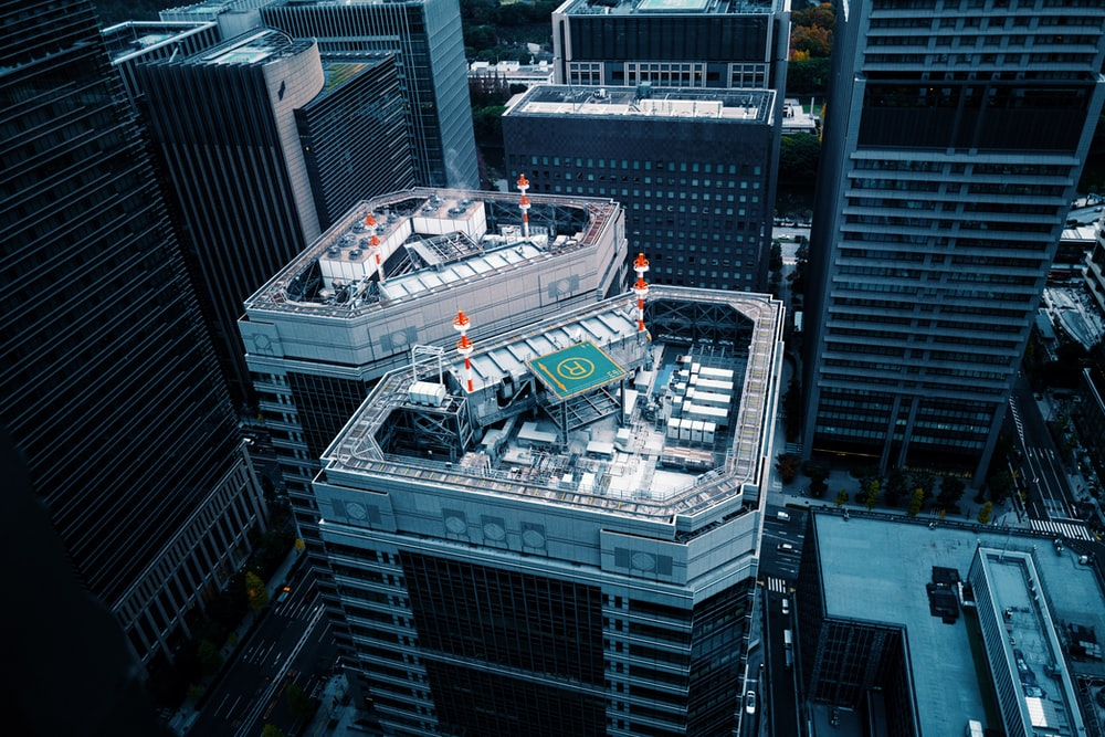 birds-eye view of high-rise building with helipad